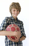 Muchacho con el balón de fútbol Imagenes de archivo