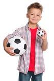 Muchacho con el balón de fútbol Imagen de archivo
