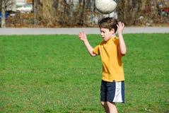 Muchacho con el balón de fútbol Fotografía de archivo libre de regalías