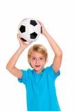 Muchacho con el balón de fútbol delante del fondo blanco Fotografía de archivo libre de regalías