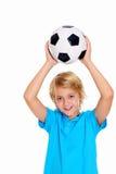 Muchacho con el balón de fútbol delante del fondo blanco Fotos de archivo libres de regalías