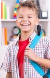 Muchacho con el bolso de escuela Fotos de archivo libres de regalías