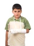 Muchacho con el brazo quebrado Imágenes de archivo libres de regalías