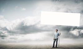 Muchacho con el cartel Foto de archivo libre de regalías