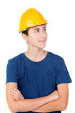 Muchacho con el casco amarillo Un arquitecto futuro Imagen de archivo