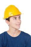 Muchacho con el casco amarillo Un arquitecto futuro Foto de archivo