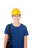 Muchacho con el casco amarillo Un arquitecto futuro Imagen de archivo libre de regalías