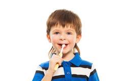 Muchacho con el cepillo de dientes Foto de archivo
