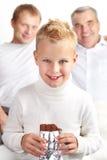 Muchacho con el chocolate Foto de archivo