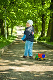 Muchacho con el coche del juguete Imagen de archivo libre de regalías
