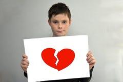 Muchacho con el corazón quebrado Imagenes de archivo