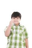 Muchacho con el dedo para arriba Foto de archivo libre de regalías