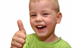 Muchacho con el dedo para arriba Imágenes de archivo libres de regalías