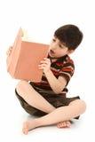 Muchacho con el libro Imagen de archivo libre de regalías