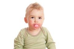 Muchacho con el maniquí de un bebé Imagen de archivo libre de regalías