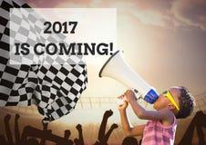Muchacho con el megáfono contra muestra del Año Nuevo 2017 Imagen de archivo libre de regalías