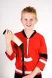 Muchacho con el palillo de hockey Fotografía de archivo libre de regalías