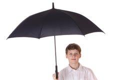 Muchacho con el paraguas Fotografía de archivo libre de regalías