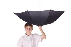 Muchacho con el paraguas Fotos de archivo