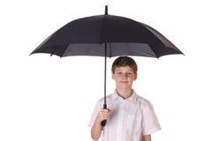 Muchacho con el paraguas Imagen de archivo libre de regalías