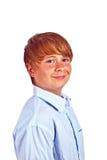 Muchacho con el pelo rubio y la camisa azul Foto de archivo libre de regalías