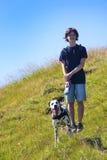 Muchacho con el perro Fotografía de archivo libre de regalías