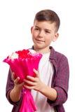Muchacho con el ramo de rosas Imagen de archivo