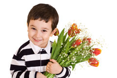 Muchacho con el ramo de tulipanes rojo-amarillos imagen de archivo