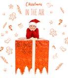Muchacho con el regalo de Navidad grande imagen de archivo libre de regalías