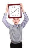 Muchacho con el reloj grande Fotos de archivo libres de regalías