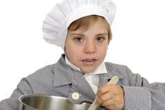 Muchacho con el sombrero del cocinero Imagen de archivo