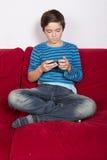 Muchacho con el teléfono Imagen de archivo