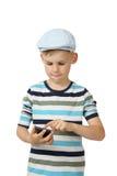 Muchacho con el teléfono celular Foto de archivo libre de regalías
