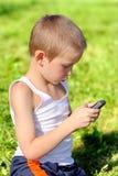 Muchacho con el teléfono móvil Imagen de archivo