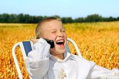 Muchacho con el teléfono móvil Imágenes de archivo libres de regalías