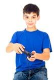Muchacho con jugar de la palanca de mando Fotos de archivo