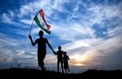 Muchacho con la bandera nacional india Fotografía de archivo libre de regalías