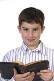 Muchacho con la biblia Imágenes de archivo libres de regalías