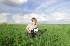 Muchacho con la bola Fotografía de archivo