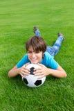 Muchacho con la bola del fútbol Imagenes de archivo
