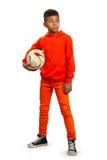 Muchacho con la bola del fútbol Foto de archivo libre de regalías