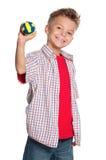 Muchacho con la bola del voleibol Fotografía de archivo