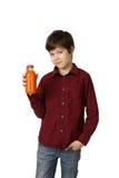 Muchacho con la botella de jugo Fotografía de archivo