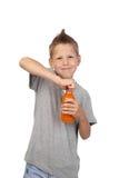 Muchacho con la botella de jugo Imagen de archivo libre de regalías