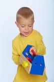 Muchacho con la caja de herramientas del juguete Fotografía de archivo libre de regalías