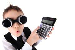 Muchacho con la calculadora Fotografía de archivo libre de regalías