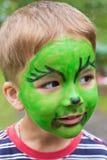 Muchacho con la cara pintada Imagen de archivo libre de regalías