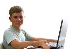 Muchacho con la computadora portátil Imagenes de archivo