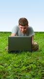 Muchacho con la computadora portátil Imagen de archivo libre de regalías