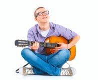 Muchacho con la guitarra española clásica Imagen de archivo libre de regalías